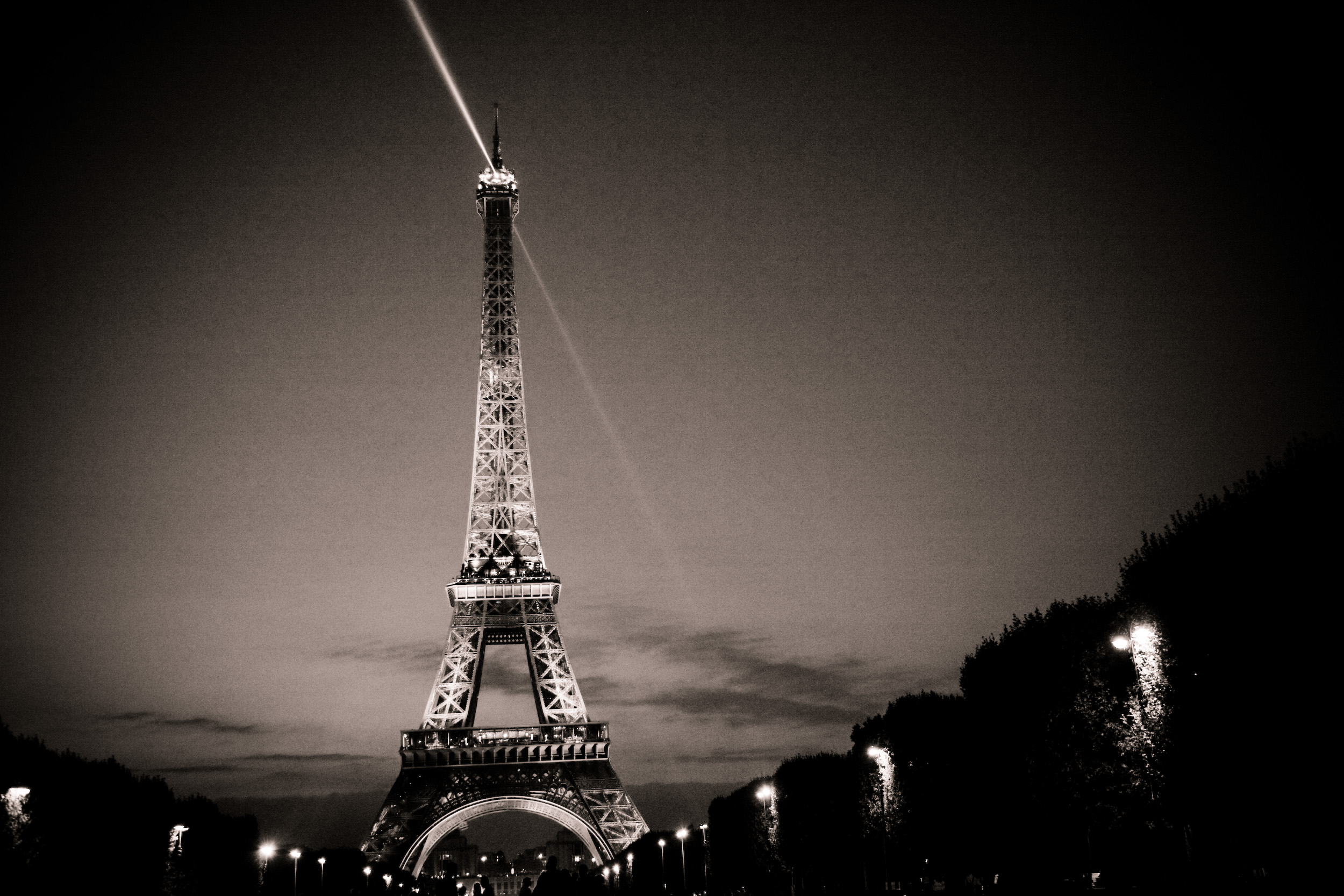 A duotone conversion of anotherwise vibrantly colorful Eiffel Tower at dusk.  Mell and I had a picnic on the Champ de Mars and watched night fall over the Eiffel.