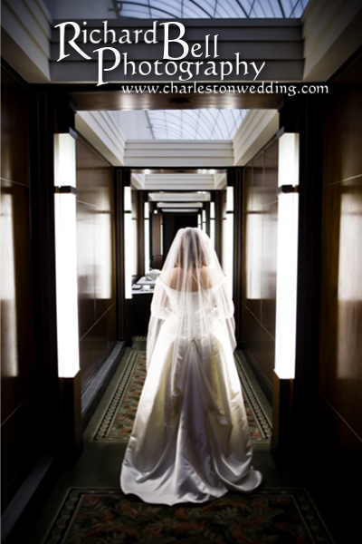 This hallway is a dream for a photographer.  Columns of light!  Who has collumns of light??